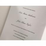 Textured canvas wedding card folded into three