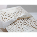 Cream wedding invitation with ribbon accent